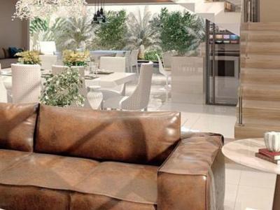 decoração com sofá marrom